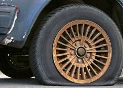 Як замінити колесо без домкрата (Фото)